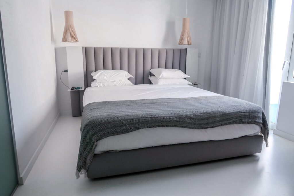 Large bed in room - Hotel California in Albuferia Old Town, The Algarve Portugal | eco-friendly, vegan, adults-only hotel with a modern twist | On The Beach Holidays Review | Elle Blonde Luxury Lifestyle Destination Travel Blog