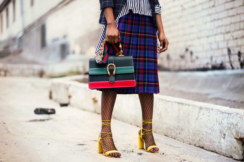 Girl holding Gucci Dionysus Clutch Bag| 4 Tips For Creating A Greener Wardrobe For Sustainability | Fashion Tips & Guide | Elle Blonde Luxury Lifestyle Destination Blog