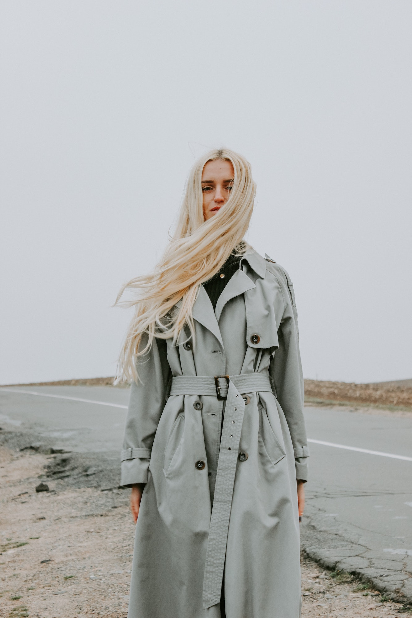 Blonde girl in trench coat   4 Tips For Creating A Greener Wardrobe For Sustainability   Fashion Tips & Guide   Elle Blonde Luxury Lifestyle Destination Blog