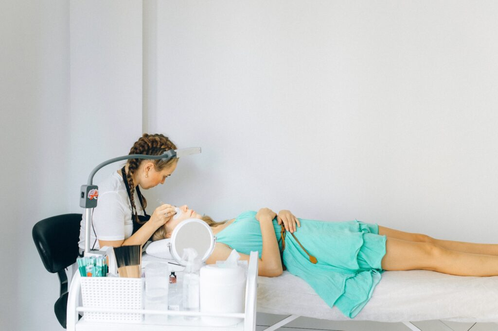 Woman plucking eyebrows | 5 Eyebrow Shaping Tools | Beauty | Elle Blonde Luxury Lifestyle Destination Blog