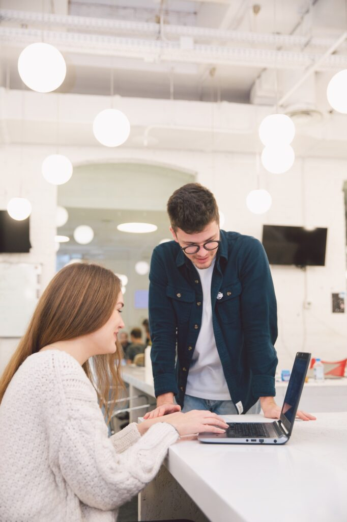 Man and woman at desk with laptop | What Do You Need To Be An HR Consultant? | Business & Education | Elle Blonde Luxury Lifestyle Destination Blog