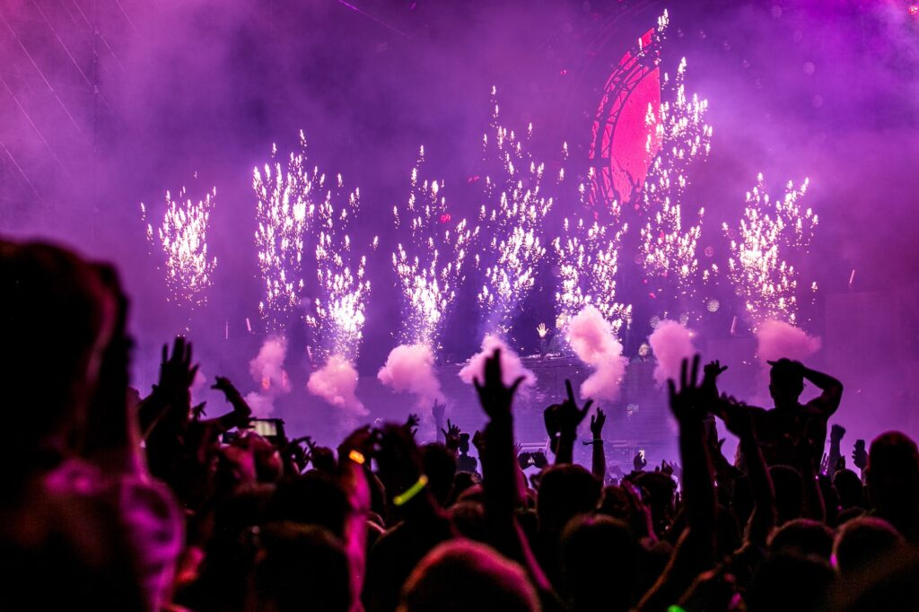 Stage with fireworks   What Do I Wear to a Rave?   Fashion   Elle Blonde Luxury Lifestyle Destination Blog